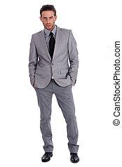 Úspěšný obchodník v obleku na plný noze