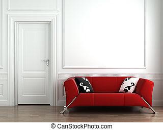 Červený gauč na bílé zdi