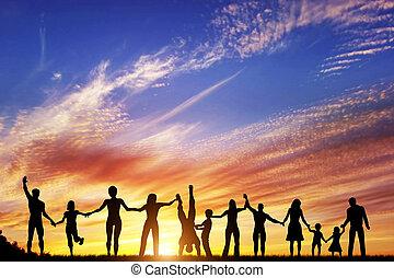 Šťastná skupina různých lidí, přátel, rodin, tým v ruce