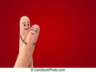 Šťastný pár zamilovaných s úsměvem a objímáním