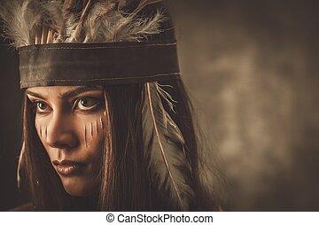 Žena s tradičním oblečením a barvami