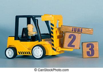 23. června. 23. den, stavba nebo kalendář. Žlutá hračička, která se nalodí na dřevo. Plánování a řízení času. Letní měsíc, den roku