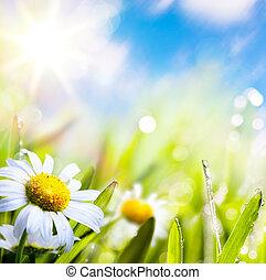 Aktivní abstraktní květina v trávě s kapkou vody na obloze