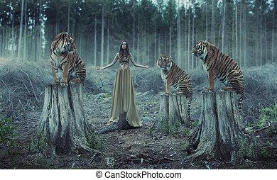 Atraktivní žena s tygry