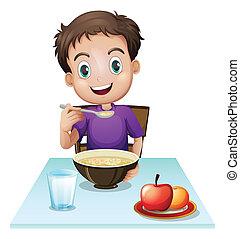 Chlapec, co snídá u stolu