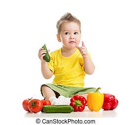 Dítě nebo dítě jedí zdravé jídlo na bílém