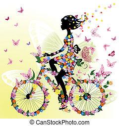 Dívka na kole v romantickém kole