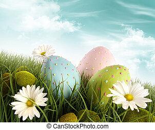 Dekoracená velikonoční vajíčka v trávě s sedmikrásky