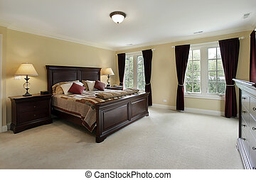 Hlavní ložnice s mahagonovým nábytkem