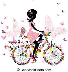 Holka na kole s romantickým motýlkem