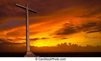 Křesťanský kříž na západ slunce. Náboženství.