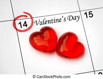 Kalendarová stránka s červenými srdcími na č. 14. den svatého Valentýna.