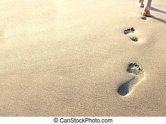 Lidské stopy v písku