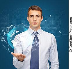 Muž držící virtuální sféru na dlani