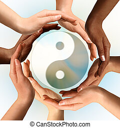 Multirakální ruce kolem Yin yang symbolu