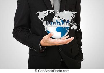 Obchodník drží malý svět v ruce