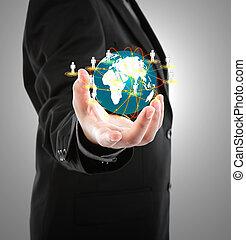 Obchodník drží malý svět v rukou