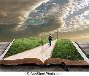 Otevřená bible s mužem a křížem