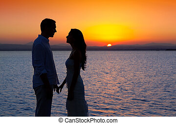 Pár mil zpět, silueta u jezera Sun západ slunce