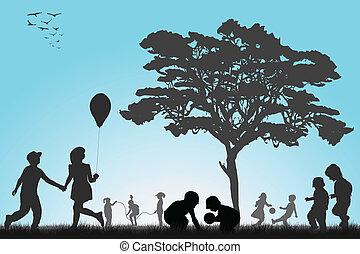 Silhouette, děti hrají venku