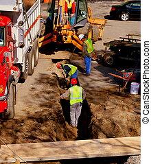 Stavební dělníky vykopávají