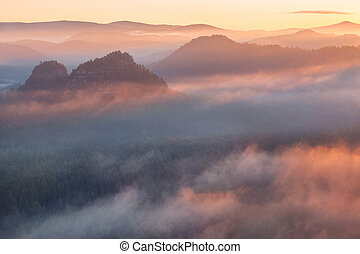 Sunrise z Kleinského zimního lesa, saxon switzerland