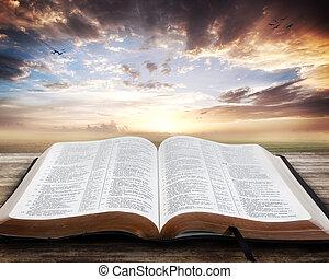 Sunset s otevřenou biblí